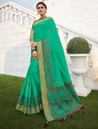 Green saree with red weaving border