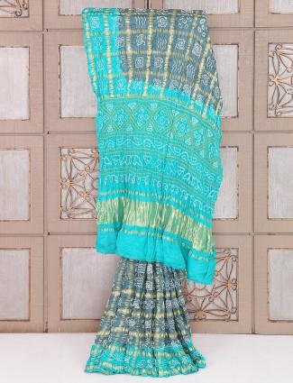 Grey and aqua color bandhej saree