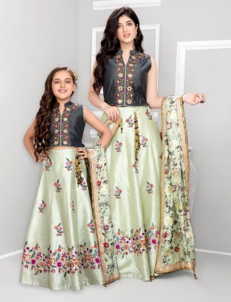 Grey and pista green matching lehenga choli for mother and daughter