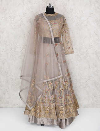 Grey color lehenga cum salwar suit in net
