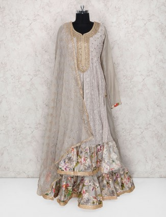 Grey colored lehenga cum salwar suit in geoegette