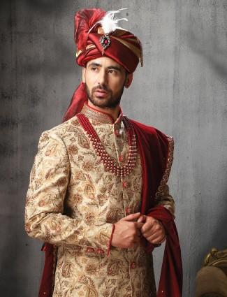 Groom wear beige color jamawar sherwani