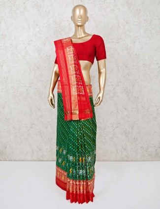 Hydrabadi patola silk saree in green and red with matching blouse piece