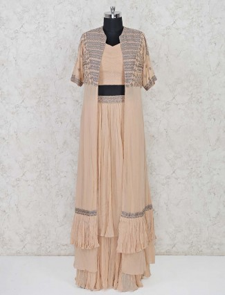 Jacket style peach colored lehenga suit