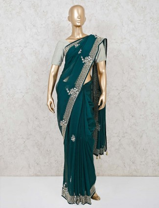 Latest bottle green saree in georgette for wedding