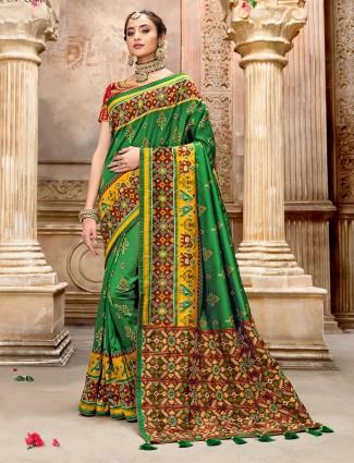 Latest green pure patola silk saree for weddings