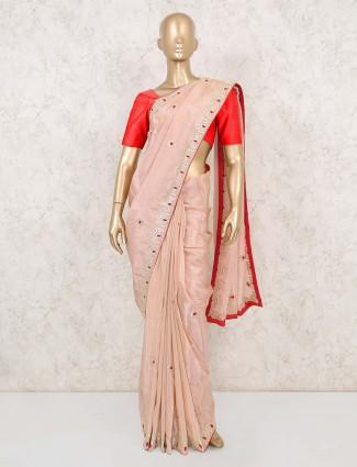Latest peach satin saree for festive wear