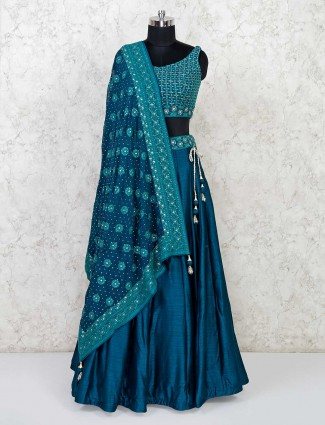 Latest raw silk wedding lehenga in rama green