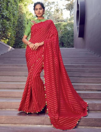 Latest red cotton silk saree with contrast blouse piece