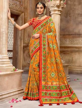 Latest wedding wear orange pure patola silk saree
