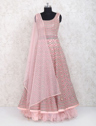 Layered style pink colored anarkali suit in net fabric