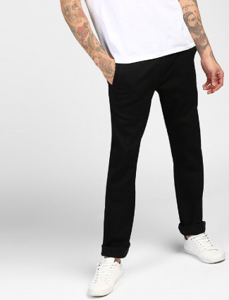 Levis plain black skinny jeans