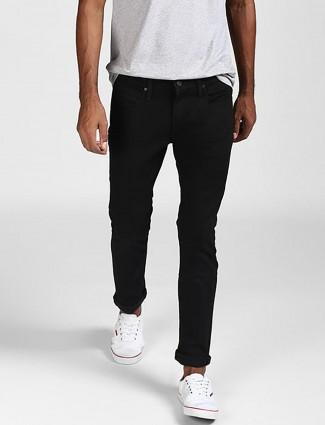 Levis solid black hue slim fit jeans