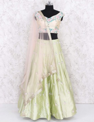 Light green colored silk lehenga choli for party