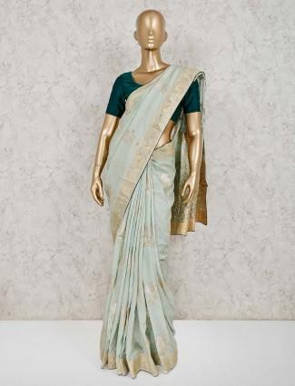 Light green dola silk zari weaving saree