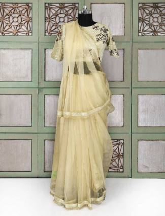 Beige party wear saree with ready made blouse