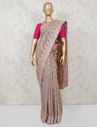 Light onion pink striped style saree in dola silk for wedding