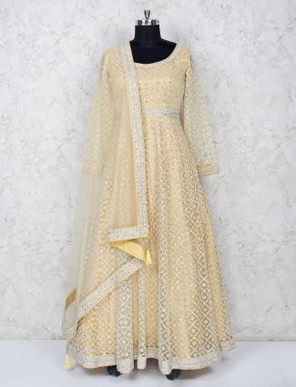 Light yellow net floor length anarkali salwar suit