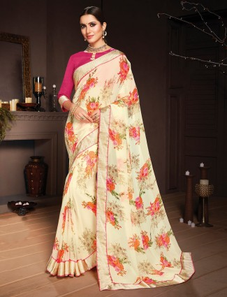 Light yellow printed saree in georgette with zari border
