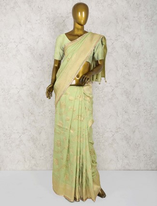 Lovely green color cotton silk saree