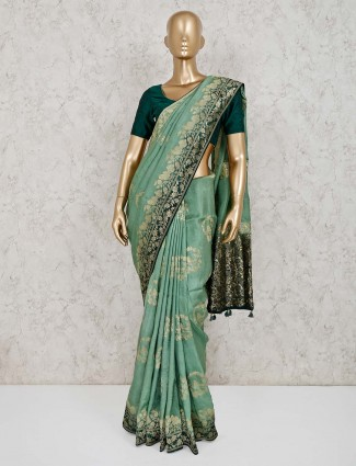 Lovely green wedding saree in muga silk