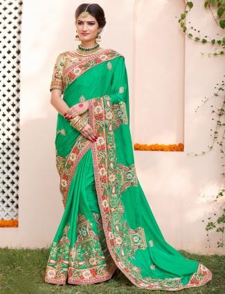Lovely green wedding wear saree