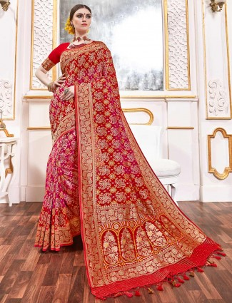Magenta and red wedding saree in bandhej georgette