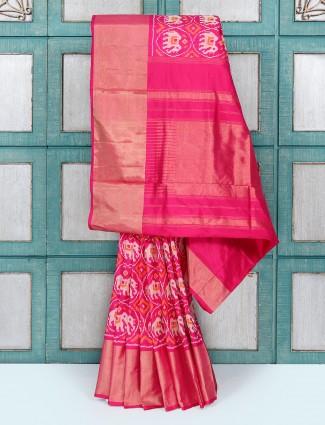 Magenta coloured silk fabric wedding saree