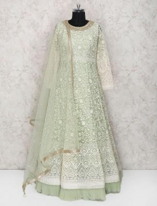 Mint green raw silk frill style anarkali suit
