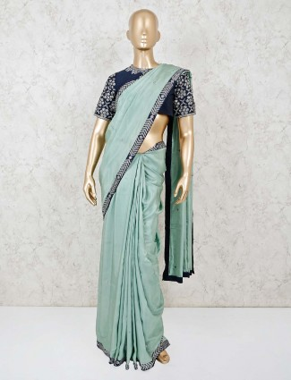 Mint green satin saree with the navy readymade blouse