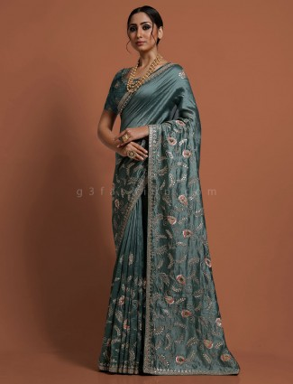 Muga silk teal green designer saree
