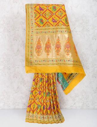 Mustard yellow color wedding wear semi silk saree