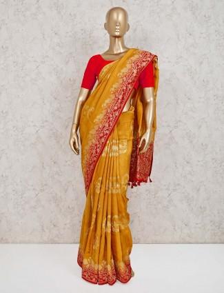 Mustard yellow dola silk saree