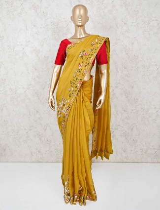 Mustard yellow organza saree with embroidery