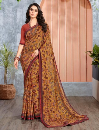 Mustard yellow printed georgette saree