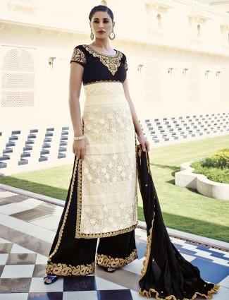 Nargis Fakhri designer party wear net semi stitich cream straight salwar suit