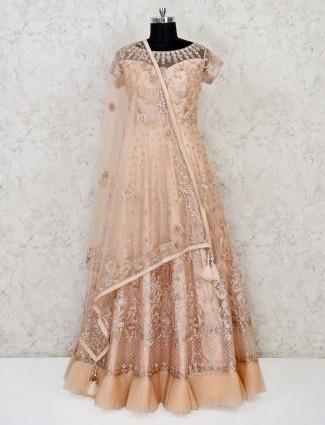 Net designer peach gown in wedding
