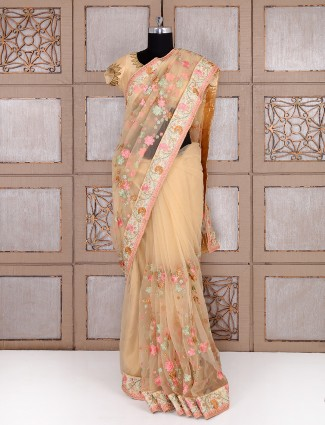 Net fabric beige color party wear saree