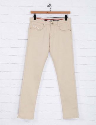 Nostrum beige color solid cotton trouser