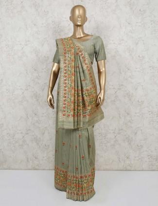 Olive green semi banarasi silk saree with thread and zari weaving