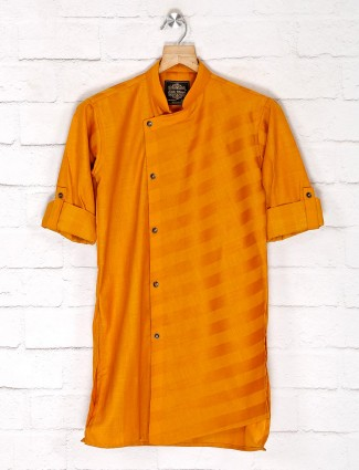 Orange color festive wear cotton kurta suit