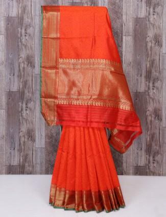 Orange color festive wear silk fabric saree
