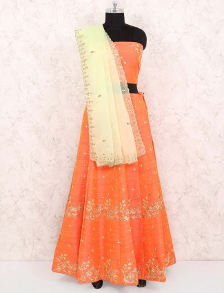 Orange color raw silk festive semi stitched lehenga choli