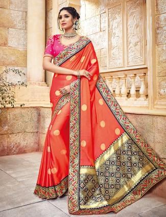 Orange color silk fabric saree for wedding