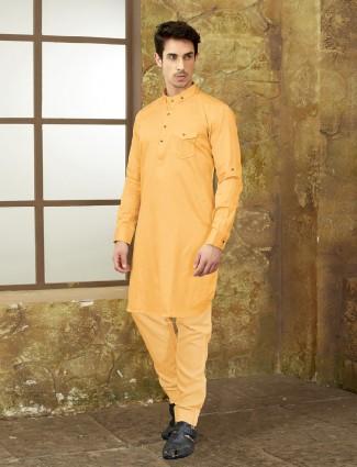 Orange colored plan pathani suit