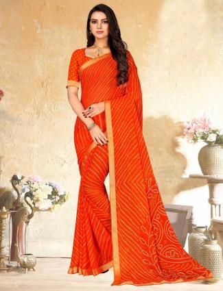Orange georgette saree with bandhej print