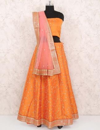 Orange hue raw silk semi stitched festive lehenga choli