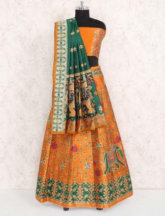 Orange hue semi stitched cotton silk fabric lehenga choli