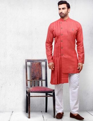 Orange hued cotton fabric kurta suit