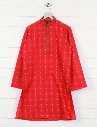 Orange hued printed cotton kurta suit
